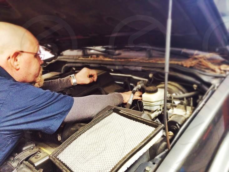 Automotive garage auto shop mechanic vehicle hood car truck engine motor muffler oil change  photo
