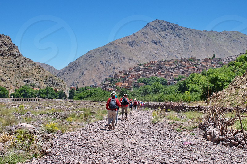 Hiking in High Atlas mountains in Morocco. Townscape of Imlil in the background photo