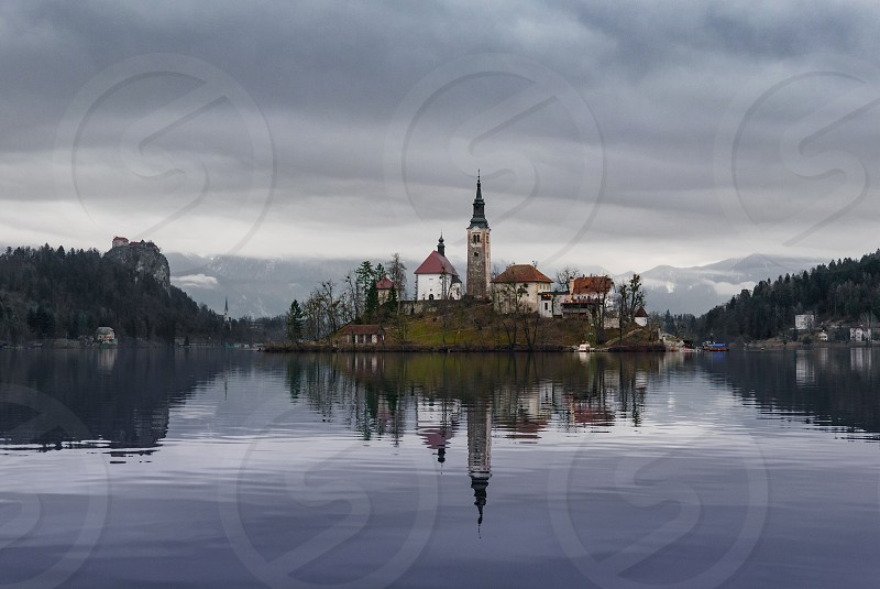 Fall to winter landscape. Church on an island on a lake. photo
