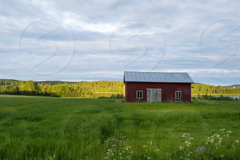 A typical red barn on the country side northeast Sweden. photo