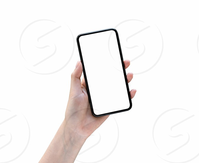Hand holding smartphone blank screen on isolated. Take your screen to put on advertising.  photo