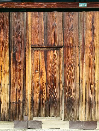 brown wooden door below 20-40 sign photo