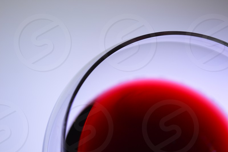 red wine in clear wine glass photo
