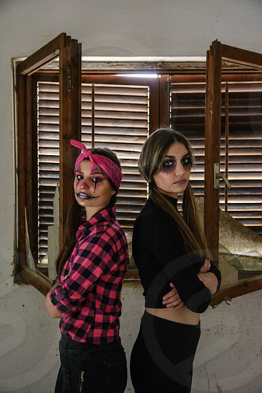 Girls getting ready for a Halloween party photo