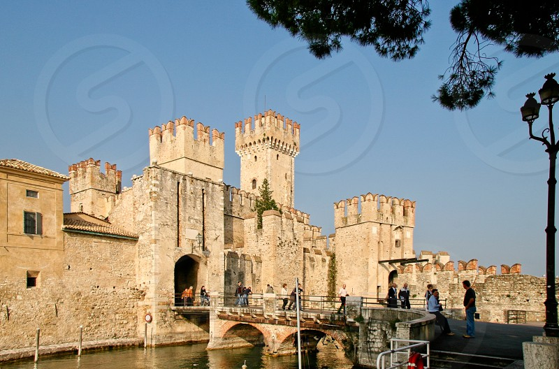 SIRMIONE LOMBARDY/ITALY - OCTOBER 27 : View of Scaliger Castle in Sirmione Italy on October 27 2006. Unidentified people photo
