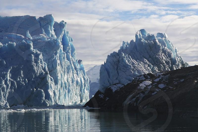 Perito Moreno Glacier in Patagonia taken from Argentino lake. It's located in Los Glaciares National Park near El Calafate city Argentina.  Photo taken in winter 2006 during a sunny day over the glacier. photo