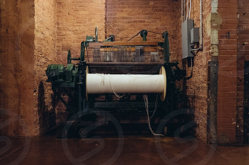 Old loom inside Mills Mill in Greenville SC. Former textile capital of the world. photo