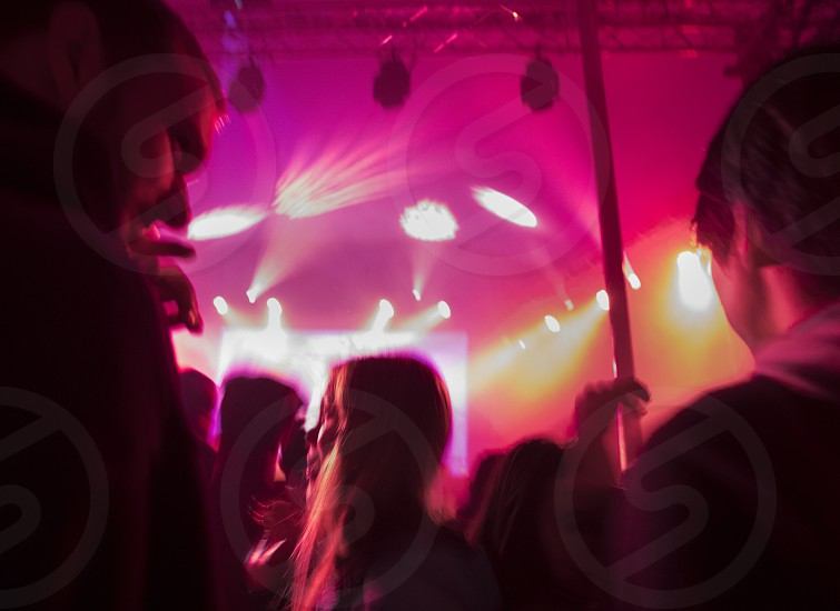 People dancing at music festival concert photo