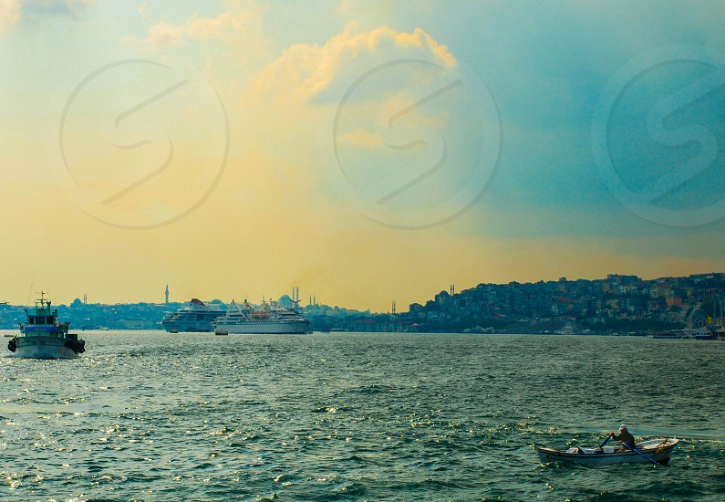 Crossing the Bosphorus Strait in Istanbul Turkey is no joke in a one-man row boat. photo