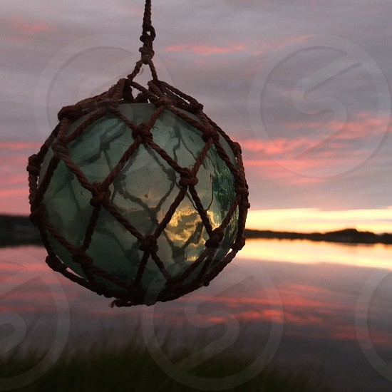green crystal ball with net covered photo
