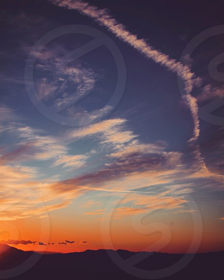 sky beauty nature hiking silhouette gradient sunsetsunrise photo