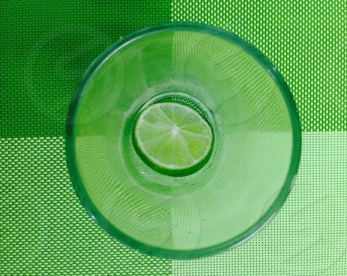 green lime on clear drinking glass photo