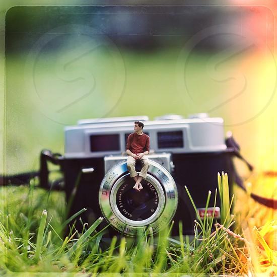 Just me sitting on my camera.  grass small mini kodak  photo