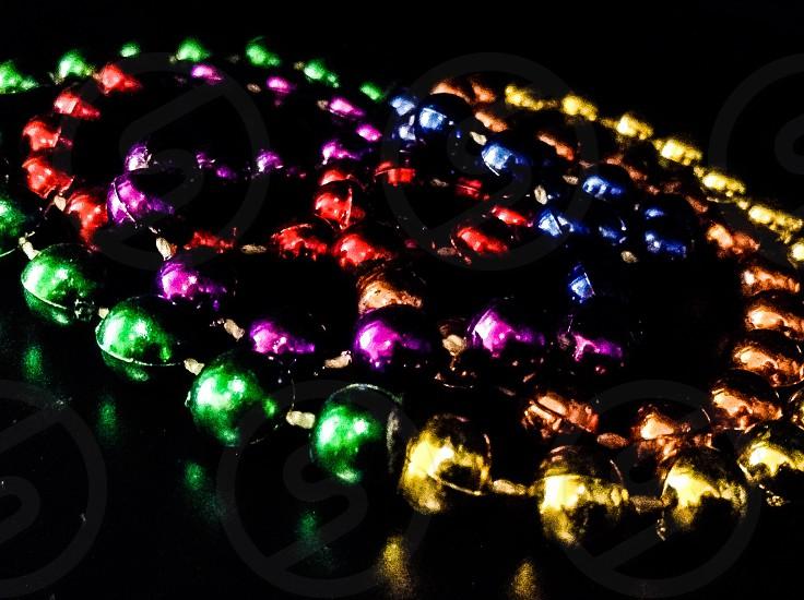 Colorful bead on black background photo