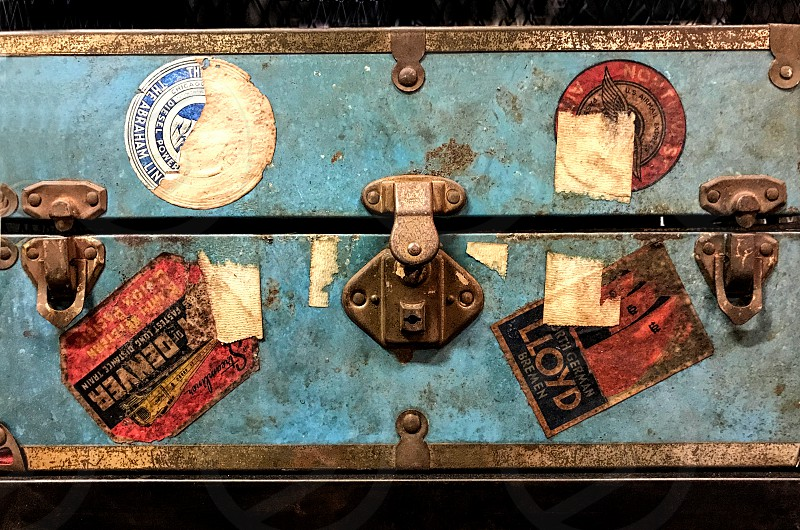 old vintage trunk with torn travel labels photo