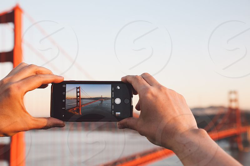 phone mobile hands san francisco Golden gate bridge sunset hands photo