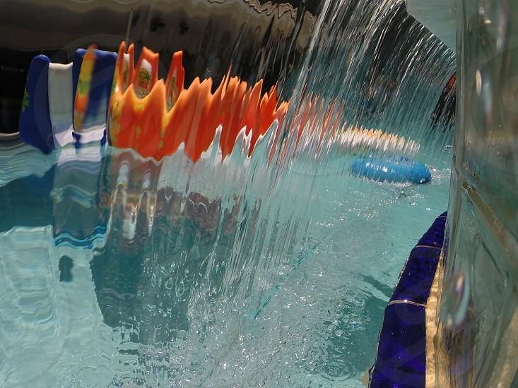 Water fall pool orange blue float photo
