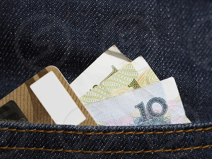 banknote and visa card in jeans pocket photo