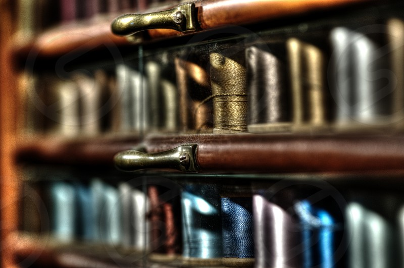 Old Display or Colorful sewing thread with a narrow depth of field. photo