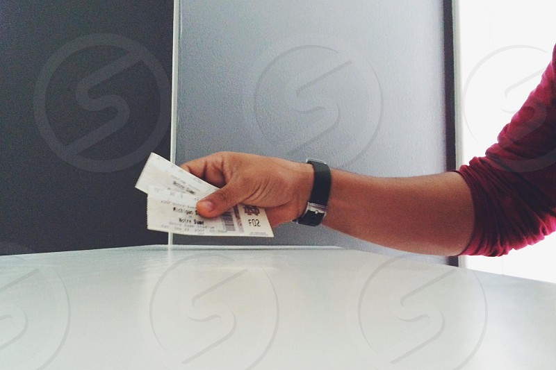 man holding out two tickets photo