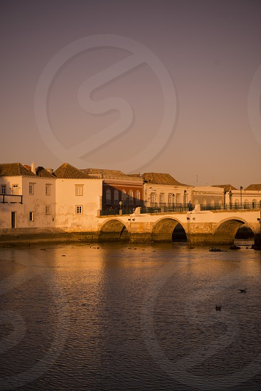 The Bridge Ponte Romana in the old town of Tavira at the east Algarve in the south of Portugal in Europe. photo
