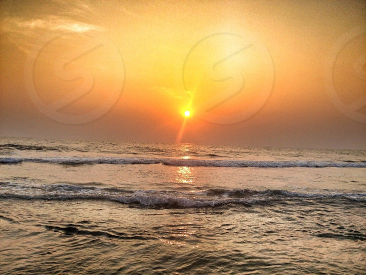 Sunset beach sea waves Varkala Kerala India photo