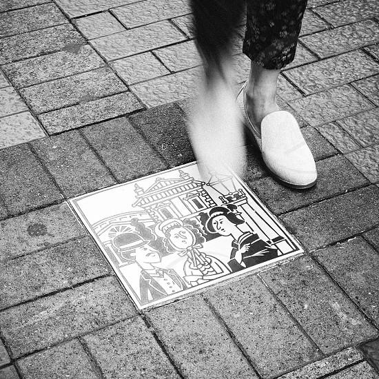 Taken in Japan.  Japan street walk pedestrian people step brick illustration almost chat culture west east modern history photo