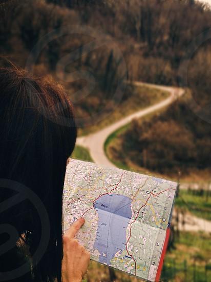 woman holding map photo