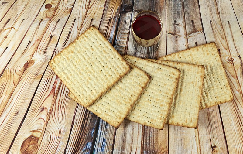 jewish judaism matzoh matza bread food matzot holiday celebration passover matzo hebrew traditional matzah seder pesach matzoth torah religious symbol ritual meal table pesah pesachah pesakh culture celebrate haggadah background texture textured israel kosher religion vintage wooden bakery tradition matzos plate spring retro festival space unleavened nobody photo