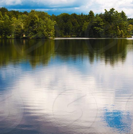 pond lake trees reflection sky clouds photo