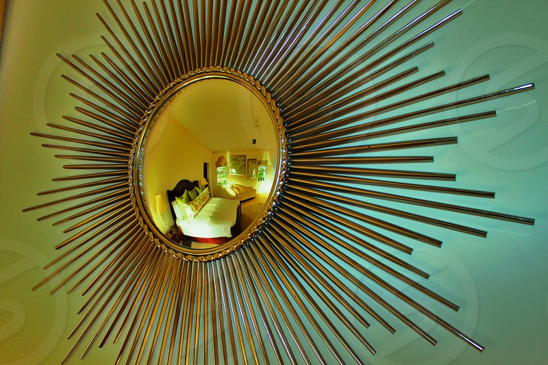 sunburst mirror with reflection of room  photo