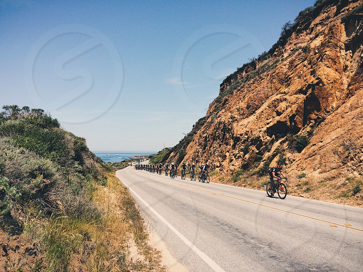 mountain bikers at the side of the road photo