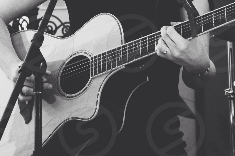 brown acoustic guitar photo