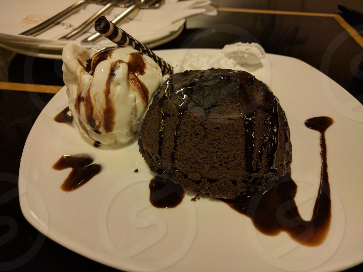 Molten Chocolate cake with ice cream and fudge. photo