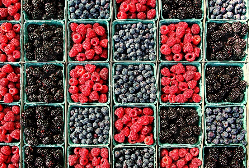 Raspberries blackberries and blueberries straight from the farm in for sale. photo