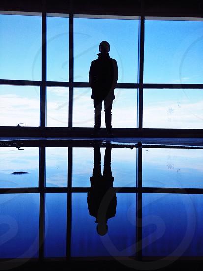 man on glass window silhouette  photo