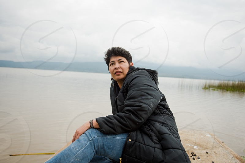 Short haired woman enjoying by a lake   photo