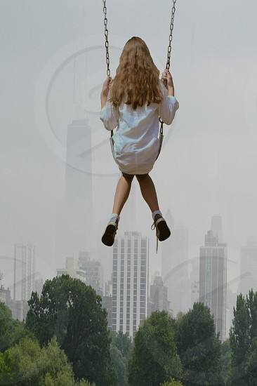 woman in white outfit on a swing photo