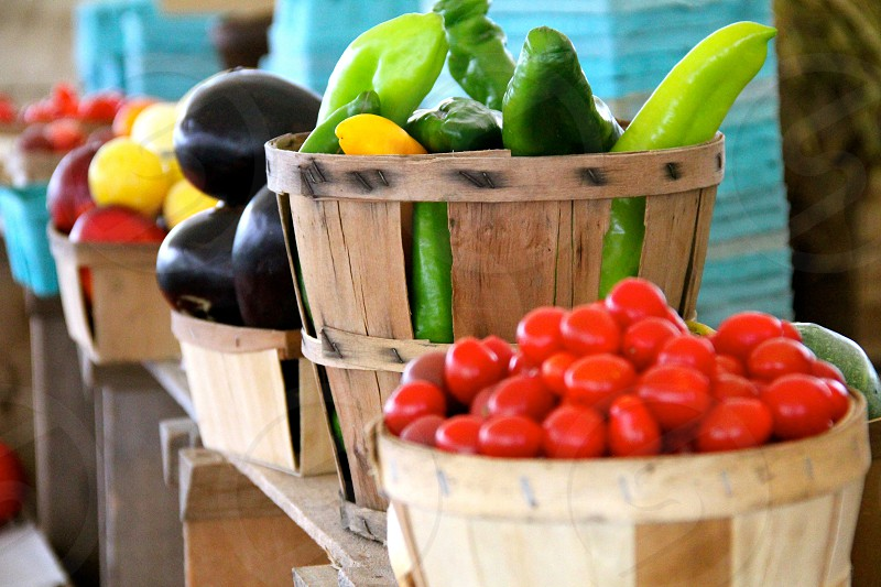 Veggie Delight - a shelf is full of diverse vegetables on display in a farmers market.  photo