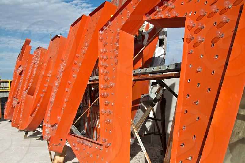 orange metal sign photo