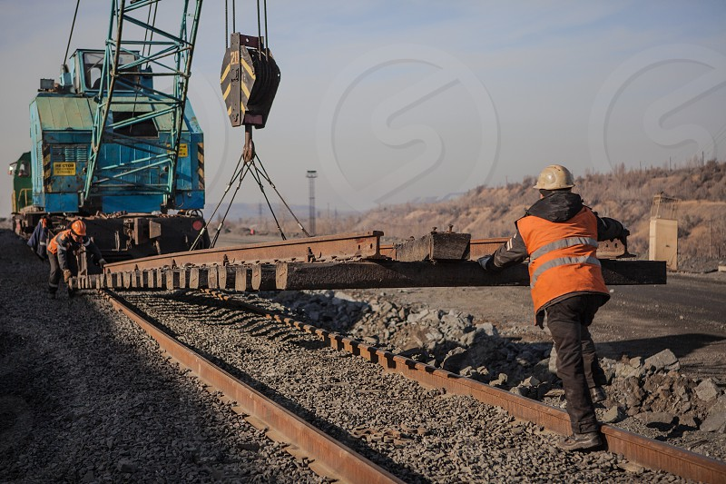 construction workers assembly the segment of train construction railway project photo