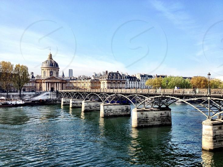 grey concrete bridge over body of water photo