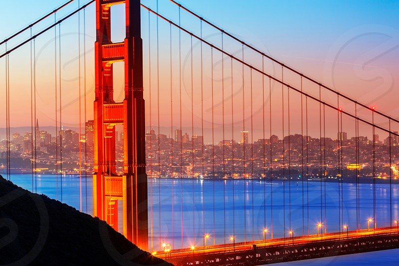San Francisco Golden Gate Bridge sunrise view through cables in California USA photo