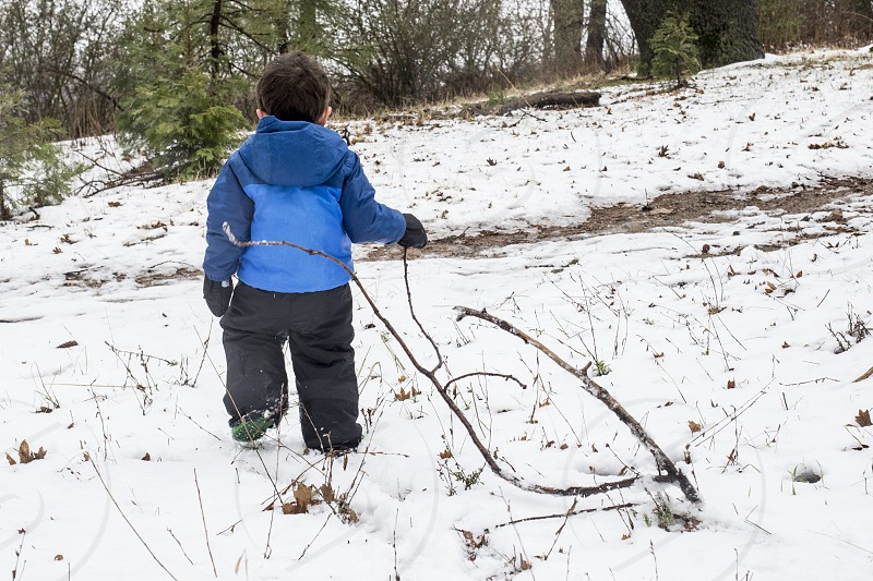 Little boy in snow photo