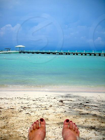 blue sea and grey sand photo