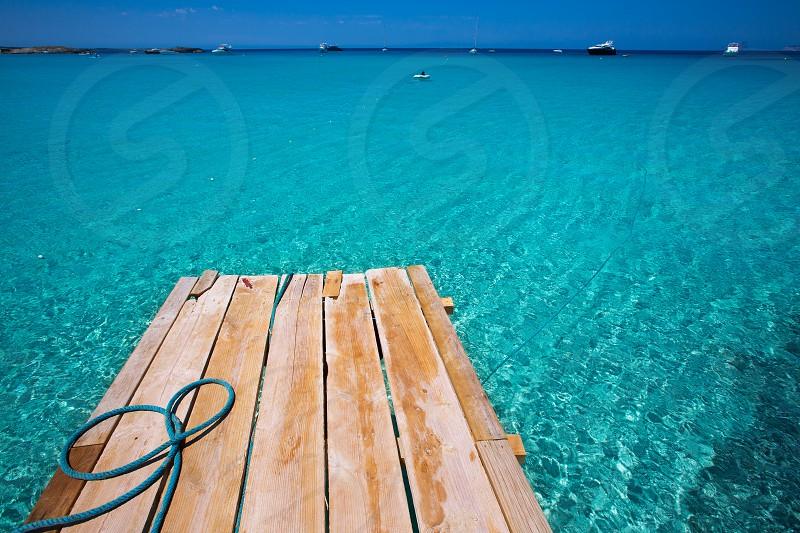 Formentera Ses Illetes beach pier Illetas with Ibiza background at balearic islands photo