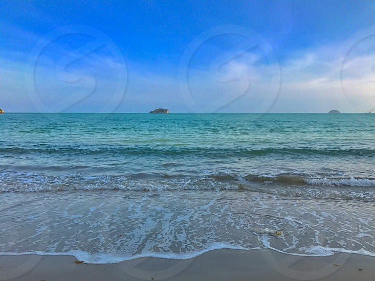 beach sea seaside wave breeze sand ocean clear turquoise blue green island silence peace alone calm relax empty Thailand Chumphon photo
