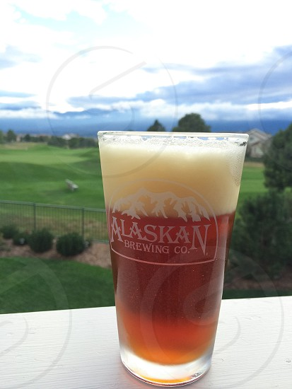 Enjoying a brew while looking towards the mountains  photo