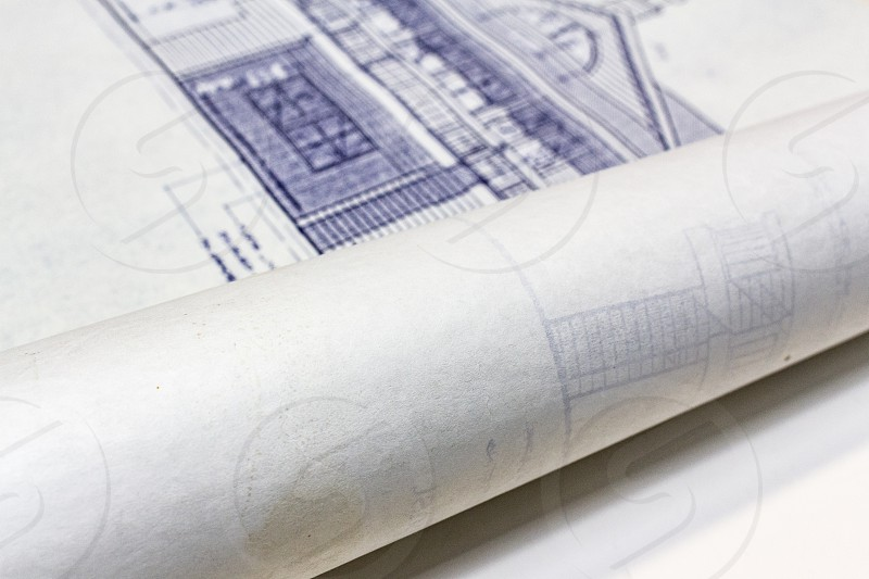 Home construction blueprints rolled up. photo
