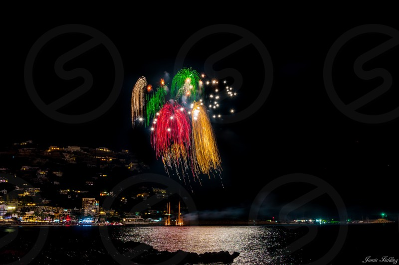 Fireworks firework light celebrate festival fiesta sea colour explosion vibrant Spain  photo